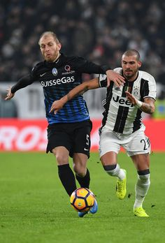 Stefano Sturaro (R) of FC Juventus competes with Andrea Masiello of Atalanta BC during the TIM Cup match between FC Juventus and Atalanta BC at Juventus Stadium on January 11, 2017 in Turin, Italy.