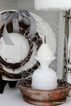 wire cloche DIY for $1.04! use a tray under it for serving, or use to display favorite objects, like things at the tea party!