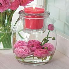 pink peonies and pink candle in hand blown glass vase/candle holder by PartyLite Candles #spring #homedecor Get your partylite collection for free ...Ask me how at michellemybell4@hotmail.com  Independent Partylite Consultant