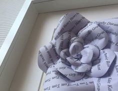 Brand new product from Karolina Rose! Personalised paper roses on coloured paper. Can feature family names or wedding dates. Great gifts for families and weddings too! See more colour choices on our Etsy shop... #WeddingFavours #GiftIdeas #PaperRoses #UniqueGift Framed or Unframed Lilac Paper Rose