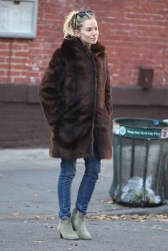 sienna-miller-fur-coat-skinny-jeans-green-ankle-boots-via-thefashionspot