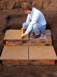 Learn how to build outdoor steps in a sloped area using bricks and patio pavers.