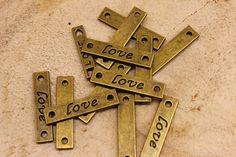 """Μεταλλικό Ταμπελάκι 50 τεμ """"Love"""" 0120283  Μεταλλικό ταμπελάκι με σκαλισμένη επιγραφή """"love"""".Η συσκευασία περιέχει 50 τεμάχια. Symbols, Letters, Icons, Lettering, Fonts, Glyphs, Letter"""