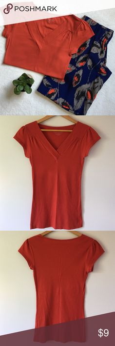 "Banana Republic Orange Ribbed Tee Cotton and spandex ribbed v-neck tee. Cap sleeves. 14"" pit to pit flat across bust. 26"" shoulder to bottom of hem. 92% cotton 8% spandex. Nice stretch! Banana Republic Tops Tees - Short Sleeve"