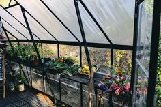 Kristin Guy is a pro at greenhouse design. The stylist and photographer DIY-ed her own plant nursery—here are her tips. Lean To Greenhouse, Dome Greenhouse, Backyard Greenhouse, Cheap Greenhouse, Greenhouse Plans, What Is A Conservatory, Green House Design, Greenhouse Interiors, Plant Nursery
