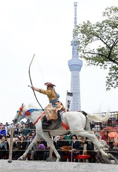 Japanese horseback archery with Tokyo Skytree in the background, Japan 浅草流鏑馬