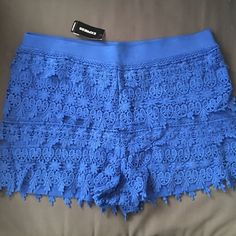 HP Express shorts. NWT Blue crochet shorts. The 3rd photo shows what they looks like on. Super flattering. Brand new with tags. All offers welcome. Host pick at the wardrobe goals party. 3/6/2016. Express Shorts