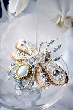 Brooch in bead embroidery. Tummy - aquamarine, and on the wings - transparent white agate. There is also the Czech crystals, Czech glass beads