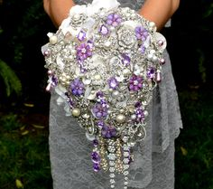This is one Bouquet you'll never stop taling about, lifetime! Deposit on lavender cascading jeweled brooch bouquet -- made to order wedding brooch bouquet Bouquet Bling, Wedding Brooch Bouquets, Crystal Bouquet, Button Bouquet, Cascade Bouquet, Purple Wedding, Dream Wedding, Wedding Day, Summer Wedding