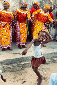Little girl joins in an African dance. ---- (Photography by Isabel Pinto)