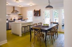 island/bar and dining table close together