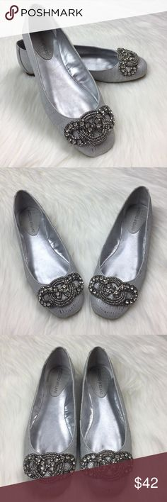 Antonio Melani Aviana Silver Metallic Ballet Flats These beauties are so pretty! They're in pristine pre-owned condition. No noticeable signs of wear from the outside. Very minimal signs of wear on the inside and soles. 👠  Size 6.5 (please refer to size chart listed in the photos if you're unsure of the fit). Leather upper, man made lining and sole.  Love them? Make me an offer! ✨ ANTONIO MELANI Shoes Flats & Loafers