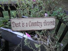 dust is a country accent, wood sign, funny sign, country sign, primitive home decor, country home decor rustic home decor. $14.95, via Etsy.