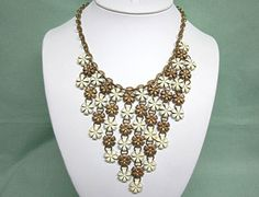 Old Brass and White Enamel Flower Waterfall Necklace by COBAYLEY,