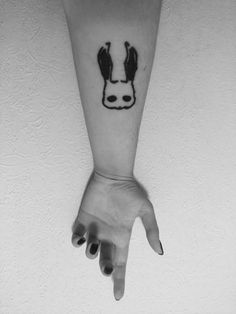 Cohen's rabbit ears tattoo