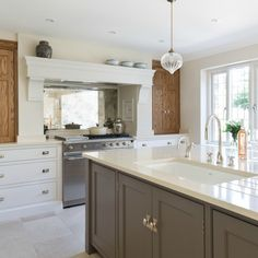 We love this shot of the range cooker in the Hadley Wood kitchen project. The painted cabinetry works beautifully with the accent smoked oak finish on the bi-fold doors either side of the range. The glass lights are by one of our favourites J Inframe Kitchen, Kitchen Cabinetry, Open Plan Kitchen, Kitchen Interior, Kitchen Ideas, Country Kitchen, Kitchen Decor, Beautiful Kitchens, Cool Kitchens