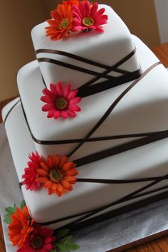 square cake design with ribbons   Ribbon Wedding Cake with Gerber Daisies — Square Wedding Cakes