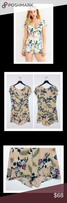 For Love & Lemons for UO Floral Romper Brand new with tags peachy-pink floral romper. Third photo shows subtle ruffle trim on the bottom. Flutter cap sleeves and full hidden zipper up the back. Mint condition. Urban Outfitters Pants Jumpsuits & Rompers
