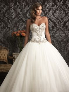 Allure Bridals: Style: 9017--An exquisite ball gown in satin and English Net. The strapless bodice features a sweetheart neckline, delicate boning, and Swarovski crystals. The ball gown skirt is gathered with a chapel train.