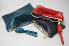Boston-based designer, Rennes, is back at NOMAD! Hand-drawn, cut, and created, these bags are made of leather and feature funky interior fabrics & a sturdy zipper.. making the perfect on the go clutch.    www.nomadcambridge.com