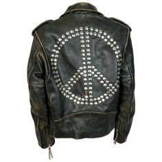 Preowned Moschino Vintage Iconic Peace Leather Jacket Circa 1990 ($2,278) ❤ liked on Polyvore featuring outerwear, jackets, black, moschino, genuine leather jackets, leather jackets, studded leather jacket and studded jacket