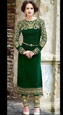 Designer Bottle Green Velvet Long Length Chudidar Set Gleam with allurement this festive season by being dolled up in this designer bottle green velvet long length chudidar set. Kameez featuring golden thread embroidered unique pattern around neckline and full sleeves. Similar work border on hemline allures beauty. Comes with matching embroidered chudidar and dupatta. Belt shown in the picture is not included. #LongLengthChudidarSet #FantasticDesignerChudidarSuits