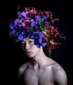 Flower art works by Hnayuishi Takaya The designer has also created a range of headdresses specifically for men, which includes a hat of large purple petals from different plant species and a headpiece made from dried twigs, grasses and roots.