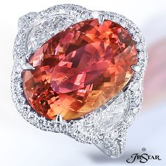 Style 0884. Such a unique color! Imperial #Topaz and Diamonds Platinum Ring with a 7.56 ct. center and 2.50 ct. in the surrounding diamonds.