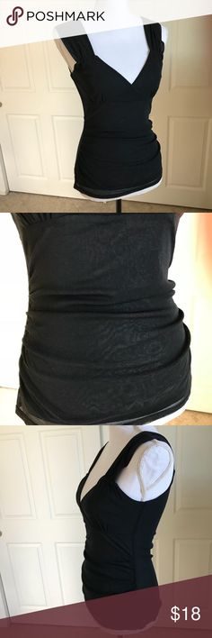 """🌟Host Pick🌟 Michael Kors Blouse Tank Top Shirt Michael Kors Tank Top V-Neck Blouse...ruching on sides, stretch...Excellent condition.   Approx. Measurements... Chest - 32"""" length - 26""""   All reasonable offers considered!  Come from my clean, Smoke/pet free home.   Thanks for looking MICHAEL Michael Kors Tops Tank Tops"""