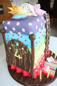 This is the princess and the pea fairy tale cake I made for my daughter's 4th birthday. This pic shows the detail of the head board. The mattress decoration was copied from another pinterest cake which I thought was wonderful (copying is apparently the sincerest form of flattery...). The cake toppers, board and bed designs are my own. I think this one took more than 100 hours to complete.