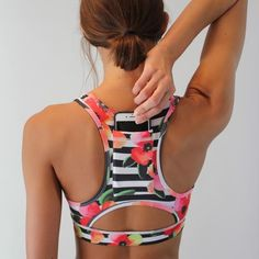 Sarah Sports Bra: includes a pocket for your phone and a beautiful floral pattern. Only $26 from www.senitaathletics.com