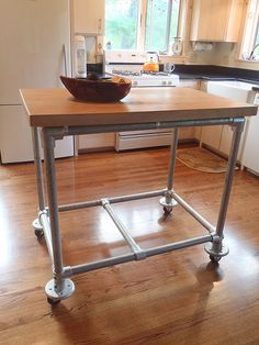 Rolling kitchen island constructed from pipe, Kee Klamp pipe fittings and a butcher block.  Inspiration to build your own rolling kitchen island.