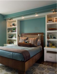 shelves and lamps flanking the bed