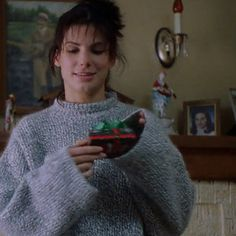 """Lucy's amazing oversized wool sweater inspires major envy. So big it can store gifts up the sleeve! 
