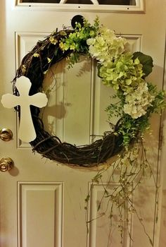 Grapevine spring wreath with hydrangeas and cross