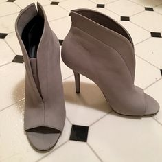 Aldo gray heeled booties.  Brand new - never worn. Gray high heeled booties (2.5 inch heel) that have a flattering cut for all styles.  Never been worn. ALDO Shoes Ankle Boots & Booties