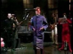 """A sobered-up Bowie in a 1979 performance of """"TVC-15"""" on Saturday Night Live, introduced by a very young Martin Sheen, and featuring Klaus Nomi dragging a large pink poodle."""