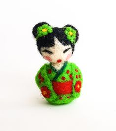 Needle Felted Green Kimono Japanese Kokeshi Wool Sculpture/Doll. DOLL/SCULPTURE ONLY - no accessories included This miniature needle felted green floral kimono kokeshi doll is the perfect collectible or Valentine's day gift. The carefully hand-crafted wool sculpture is approximately 2in tall *Please note that I try to make all of my dolls as close as possible to what is displayed but some colours and sizes may slightly vary since this item is free-hand, hand-made. **This item is for...