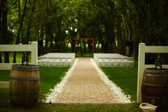 Natural Cathedral Stone Pathway with Rose Petals #carloscreekwinery #ceremonydecoration #winerywedding #outdoorwedding #rosepetals #winebarrels