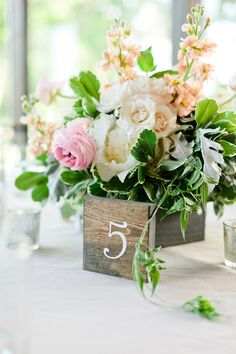 Some tables will feature gold compotes spilling with cream hydrangea, bay laurel, dusty miller, peach roses, ivory roses, fresh sage, seeded eucalyptus, peach campanella garden roses and green succulents. Short gold mercury glass votives will surround the compotes.STEMS | Barr Mansion | Jana Carson Photography