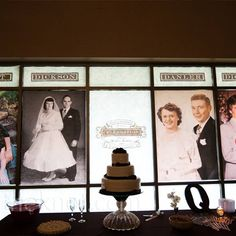 Old windows and photos of grand-parent's weddings in each pane with warm lighting behind. Beautiful display even after the wedding.