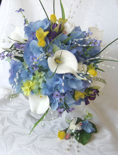 Wedding bouquet white calla lilies bridal bouquet made with blue hydrangea, real touch mini crème calla lilies, closed roses, purple cosmos, yellow trumpet flowers, small accent flowers, and pearl sprays
