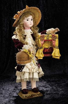 Soirée: A Marquis Cataloged Auction of Antique Dolls and Automata - May 14, 2016: Lot 17. French Musical Automaton, Bebe Triste, Toy Theatre and Pup in Basket, Gustav Vichy