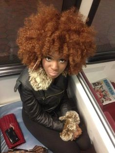 natural hair - love that she is on the metro in dc! you can tell by the express on the seat. oh I miss those commutes!