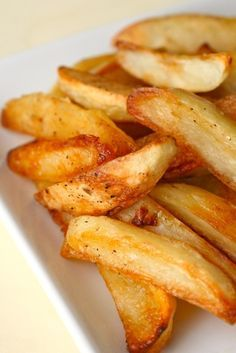 BAKED OVEN FRIES (This recipe offers a technique to make your oven fries top notch above other fries) 3 russet potatoes (about 24 oz. total), peeled and cut lengthwise into even sized wedges  5 tbsp. vegetable, canola or peanut oil, divided  ¾ tsp. kosher salt, plus more to taste  ¼ tsp. freshly ground black pepper, plus more to taste