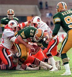 Edmonton Eskimos running back Blake Marshall #22 works his way in for a touchdown versus the B.C. Lions in this game played in Edmonton 1988.