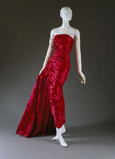 "Christian Dior (French, 1905–1957). ""Lys Noir"" evening dress, fall/winter 1957–58. Christian Dior Haute Couture (French, founded 1947). The Metropolitan Museum of Art, New York. Gift of Mme Walther Moreira Salles, 1969 (C.I.69.39). #reddress"