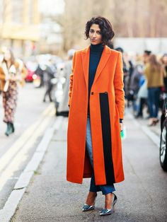 Yasmin Sewell in a bright orange coat & metallic heels