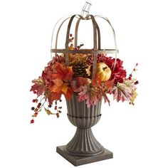 If the Greeks or Romans had pumpkins, they would have celebrated them this way, in a bronze-colored metal openwork sculpture, fairly bursting with faux foliage and ornamentals. So we've taken the liberty of carrying their classic style forward, in this our exclusive, handcrafted centerpiece for your home.