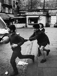 Parisian children playing in the street.  Location:	Paris, France  Date taken:	1963  Photographer:	Alfred Eisenstaedt
